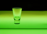glass in green poster