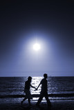 couple walking at beach poster
