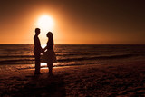 silhouette of couple at sunset poster