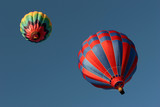 two hot air balloons from below poster