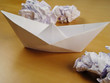 paper boat between wads