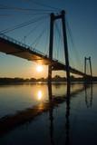 suspension bridge in sunrise poster