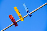 clothes-peg over blue sky poster