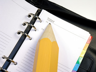 dayplanner with pencil