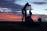 oil well at sunrise poster