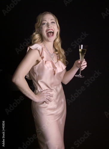 laughing woman with champagne glass