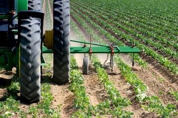 tractor plowing field closeup