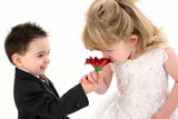 adorable young children smelling daisy together poster