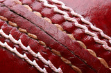 close up shot of a red cricket ball