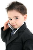adorable baby boy in suit on cellphone poster