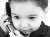 adorable baby boy in suit on cellphone in black an poster