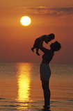 mother and child on the sea beach poster