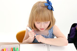 beautiful little girl at desk with box of markers poster