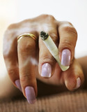female hand with a cigarette poster
