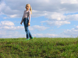 young girl on grass poster