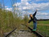 girl  balancing on rail poster