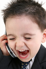 adorable baby boy in suit yelling into cellphone