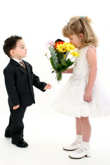 boy surprising girl with flowers