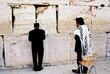 jews are praying by the western wall, jerusalem