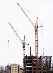 lifting cranes over frame-house