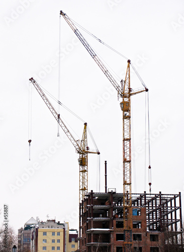 poster of lifting cranes over frame-house