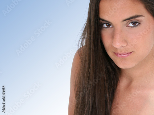 close up of beautiful teen girl over blue