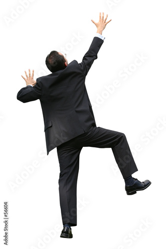 business man climbing a wall