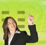 business woman pointing at something on screen - green poster