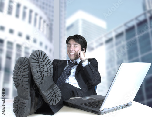 business man on the phone in his office
