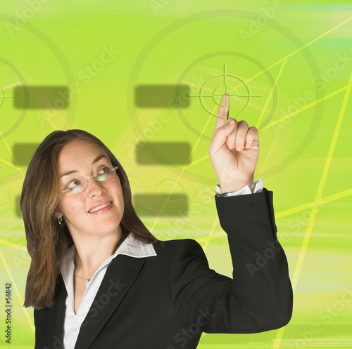 business woman pointing at something on screen - green