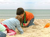 kids playing at the beach poster