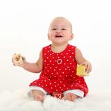 baby girl on white blanket with stork bite on uppe poster