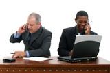 businessmen on cellphones at desk poster