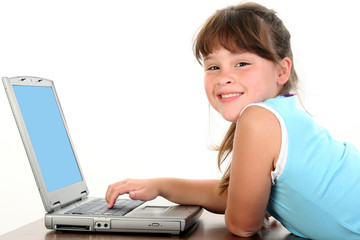 little girl working on laptop
