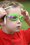 young boy with swim goggles poster