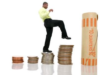 business man climbing coin stacks