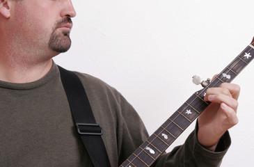 close-up of a man playing the banjo