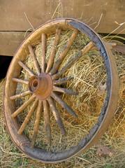 broken stagecoach wheel, portrait view