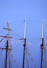 three wooden masts on a ship