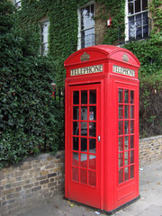 red traditional british telephone kiosk in east lo