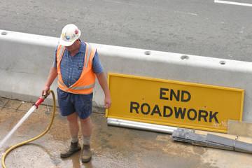 roadworker hosing