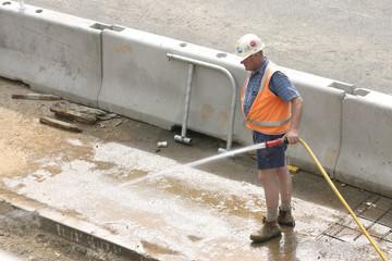 workman hosing, no sign