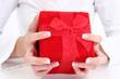hands holding red velvet gift box