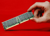 hand holding memory dimm poster