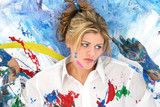 beautiful young woman splashed in paint poster
