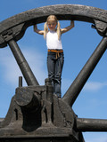 little girl and large wheel poster