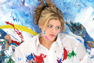beautiful young woman splashed in paint