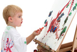 caucasian toddler boy painting at easel poster