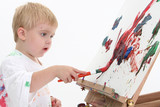 adorabletoddler boy painting at easel poster