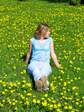 girl on dandelion lawn poster